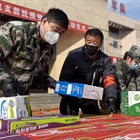 Wuhan beefs up efforts to guarantee daily needs