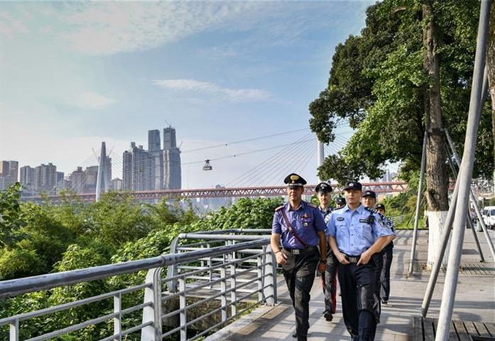 Chinese and Italian police officers patrol in Chongqing's popular tourist spots