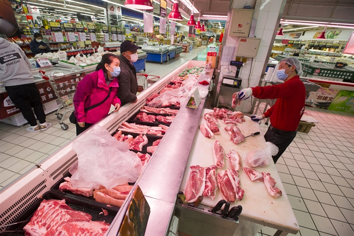 China's hog prices down 1.3 pct in mid-March