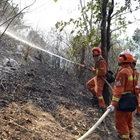 Xichang forest fire extinguished after killing 19, injuring 3; structures saved