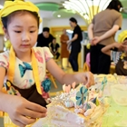 Children cake DIY competition held in Qingdao, China's Shandong
